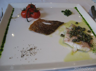Oso Ristorante Grilled Seabass with vine-ripened tomatoes
