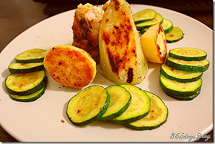 Crumbed pork with spuds and zucchini