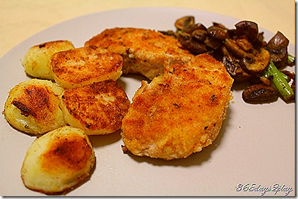Crumbed pork with spuds and mushrooms