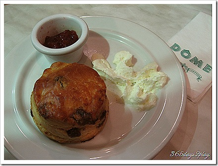 Raisin and Date Scone with Strawberry Jam and Whipped Cream