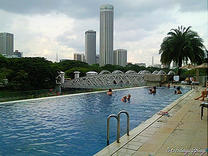 Fullerton Hotel Swimming Pool with the Swisshotel in the background