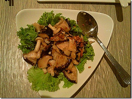Sauteed mushrooms in lettuce bed