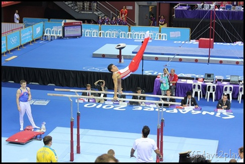 YOG Gym Indiv Apparatus Finals - Sam Oldham looks on